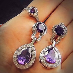 Espere Purple Zirconia Tear-Drop Dangle Drop Earrings vs an appraised Amethyst Ring