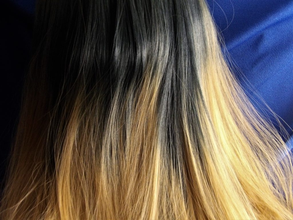 Wig color fades from brunette to dark blonde