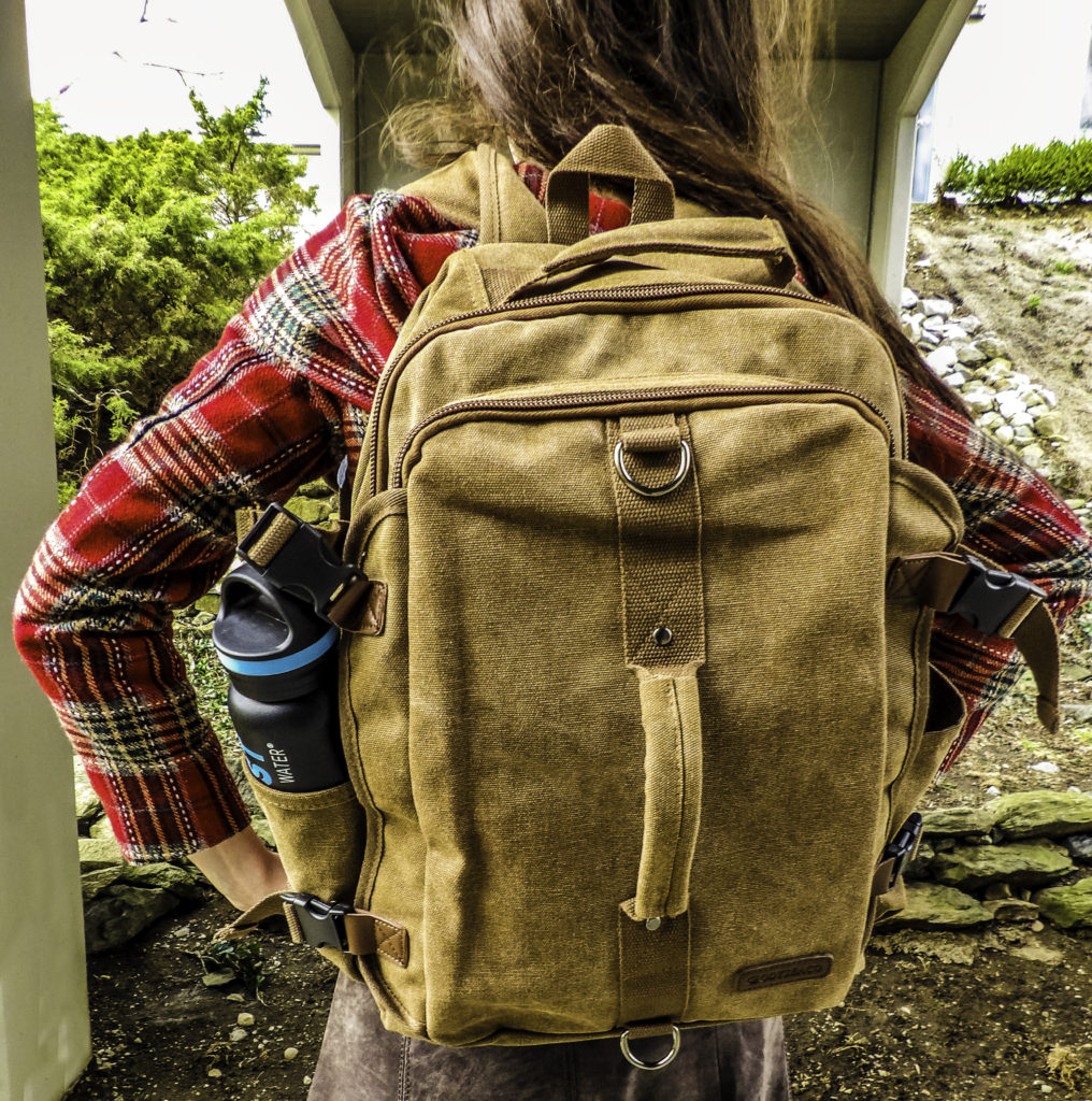 The Montera Vintage Canvas Backpack goes from the college classroom to the office in style