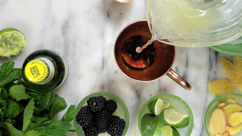 Add fresh squeezed lime juice over muddled berries and mint