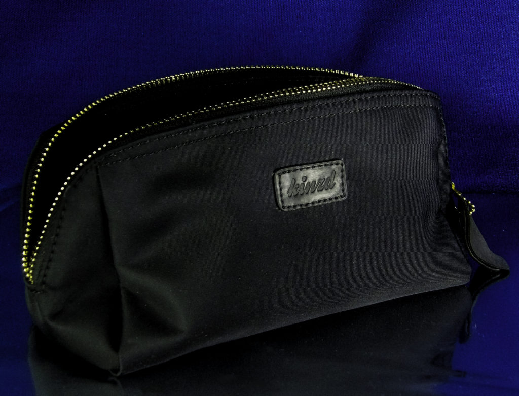 Kindz medium size bag fits into a smaller purses and bags to hold basic touchup makeup during the day