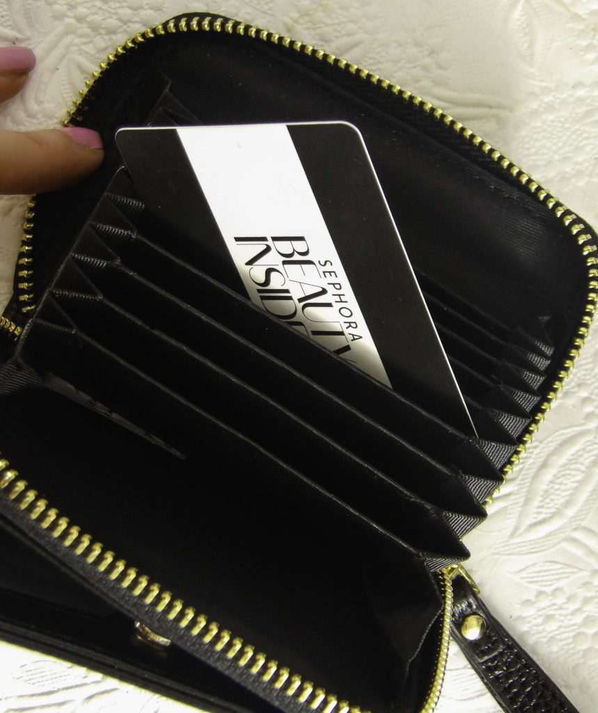 The Kinzd wallet fits numerous cards, cash and zips securely closed