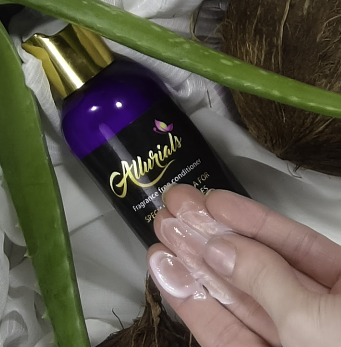 Rub the creamy conditioner between your fingers before applying to hair