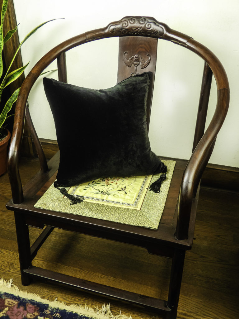 The HomeRight Black Velvet Silk Pillow warms up my stark antique side chair