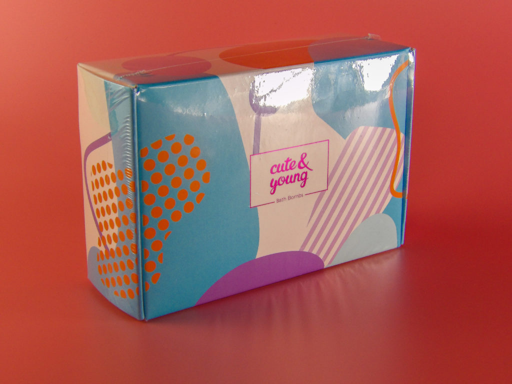 Cute gift box comes over-wrapped in plastic to keep it in gift-giving condition