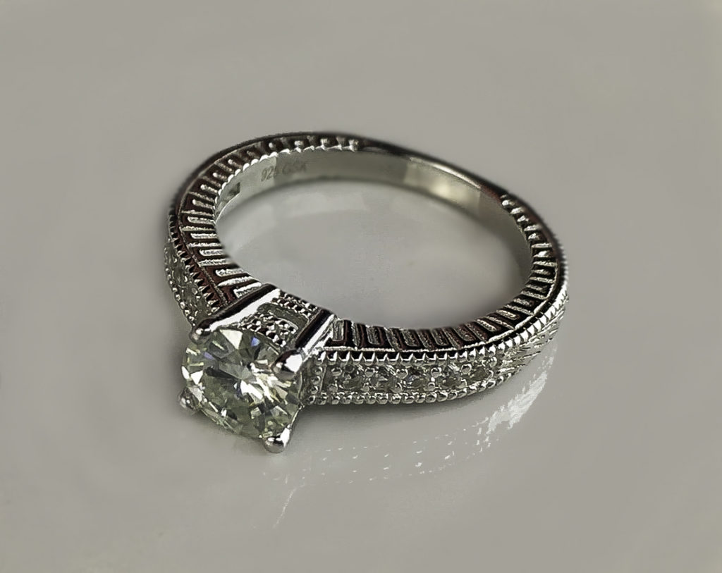 shaped clara centre is stunning diamond rings perfect that valentines engagement stage a solitaire for day setting subtle heart the ring allow proposal w side blog take romantic