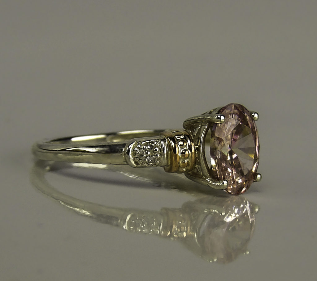 The center stone is in a classic four prong setting