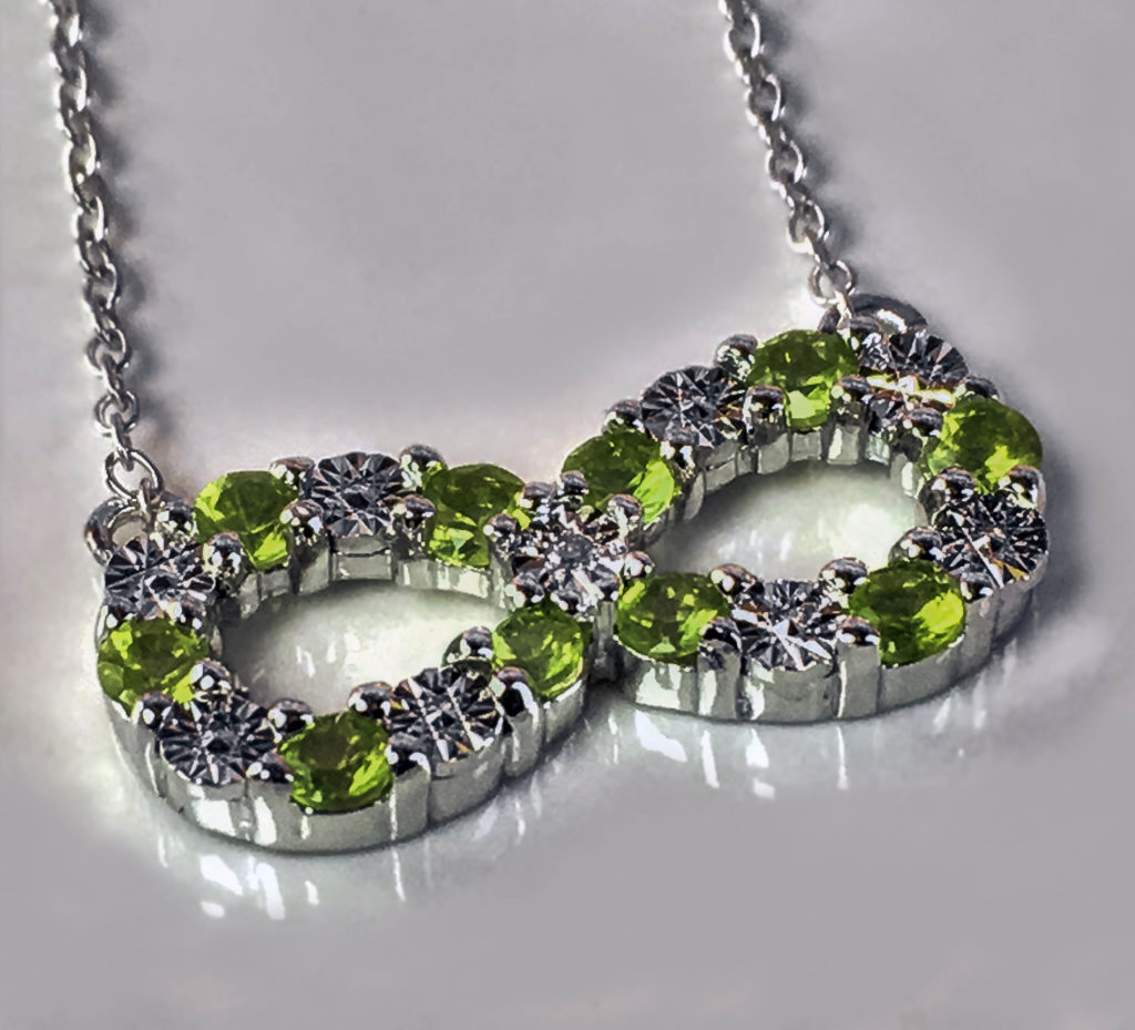 The combination of round cut Peridot gemstones, Sterling Silver and diamond has a lovely sparkle!