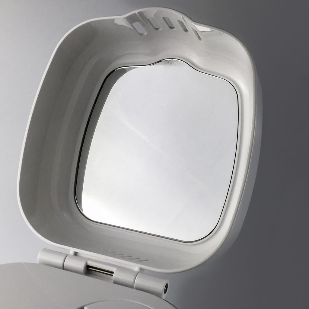 Built in adjustable angle mirror for applying product while steaming
