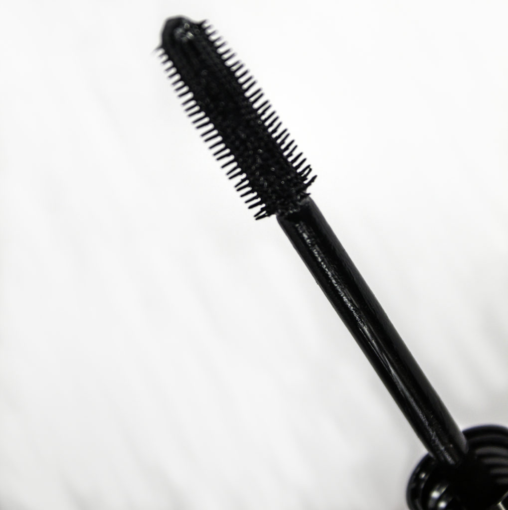 Unique bristles define and separate while coating and combing every lash