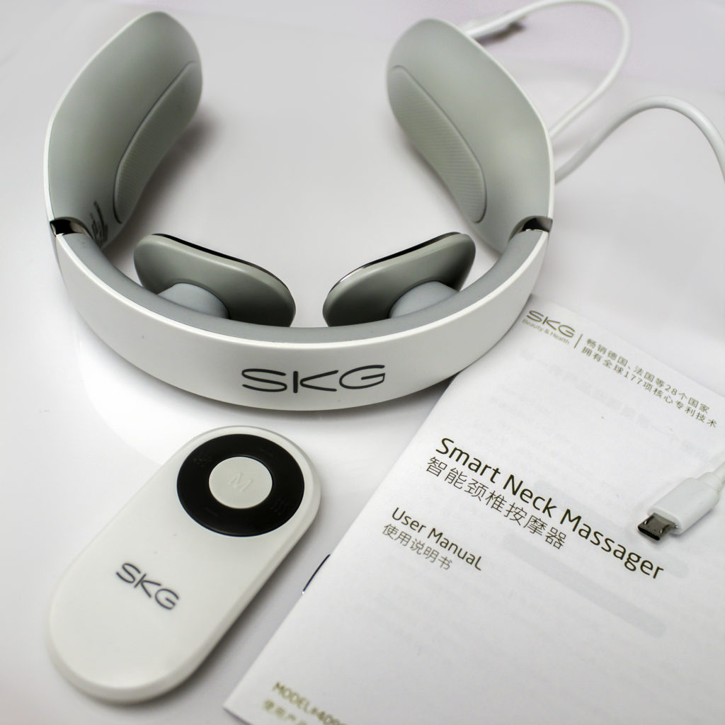 The SKG Neck Massager comes with optional remote, manual and USB charger cord