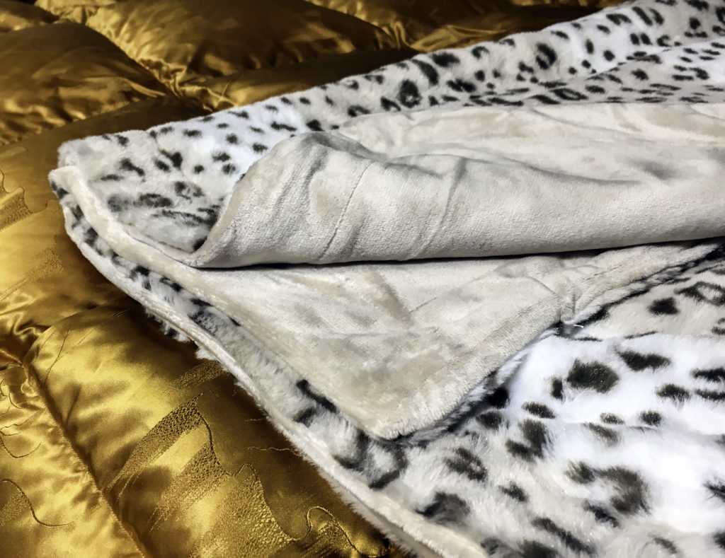 Two sided throw blanket with faux fur on one side and silky smooth microfiber on the reverse
