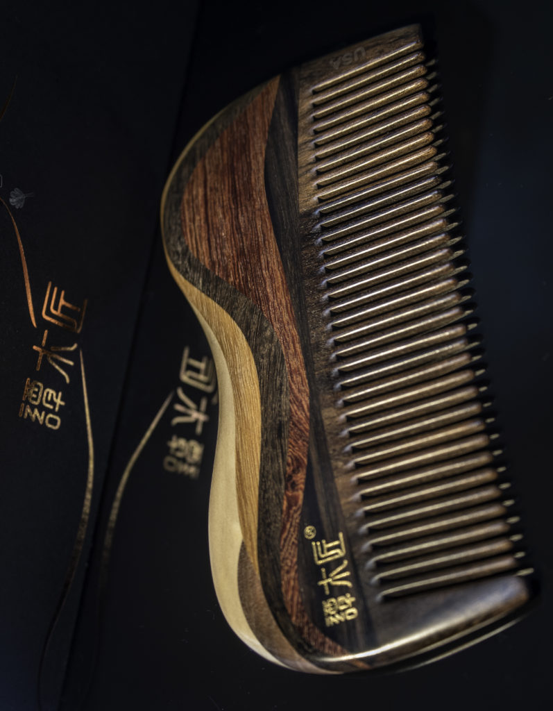 A wood comb helps distribute the oil without snagging hair