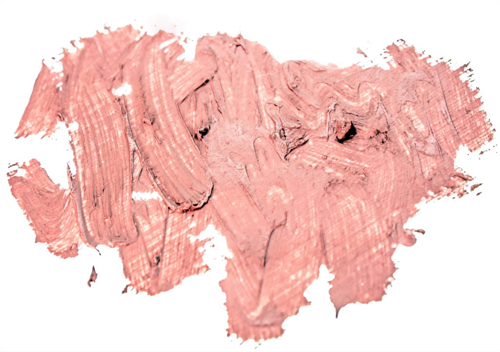 A smooth textured pink-nude lipstick