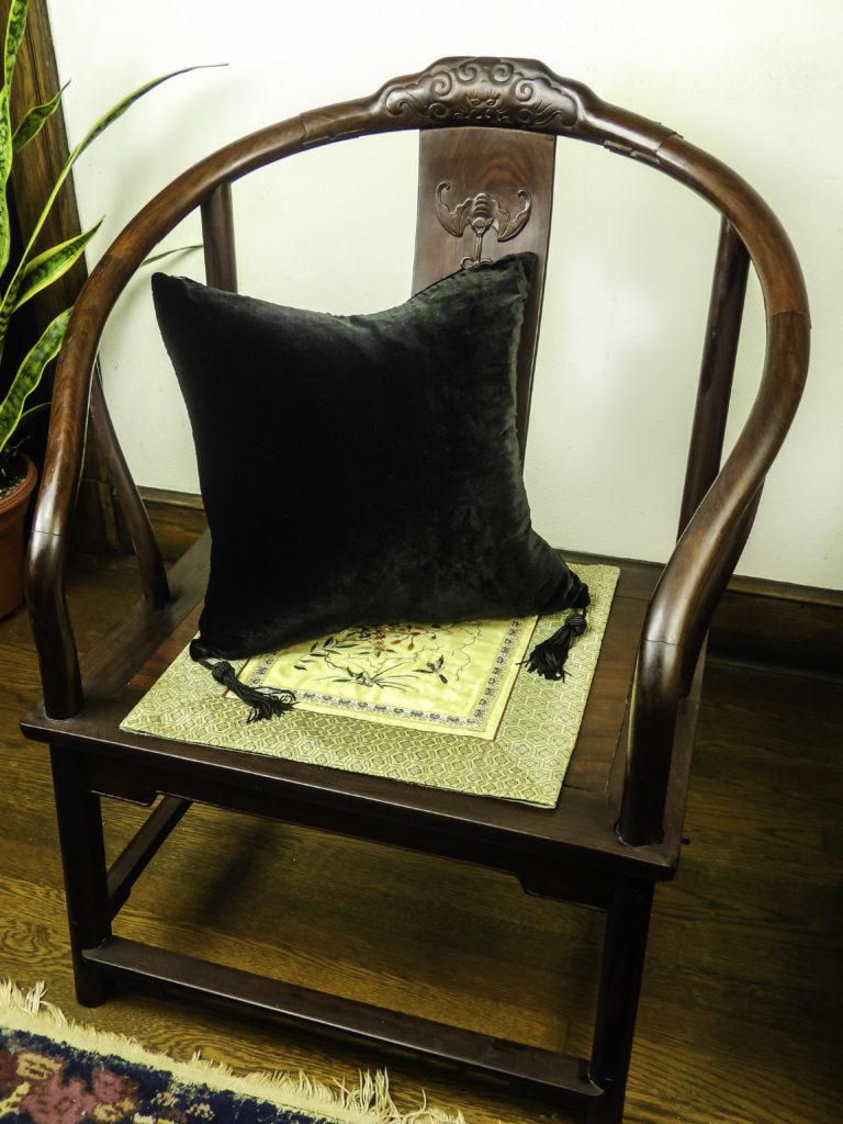 The HomeRight Black Velvet Silk Pillow warms up my stark antique side chair