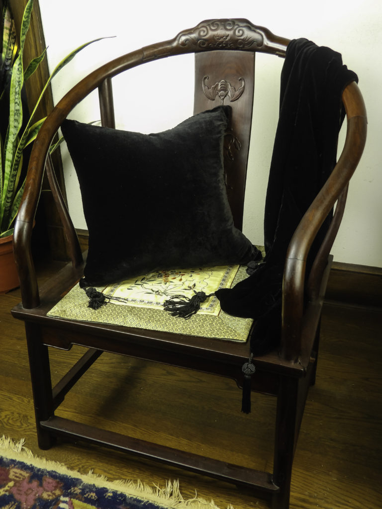 Pairing the pillow and throw together on a chair makes an inviting spot