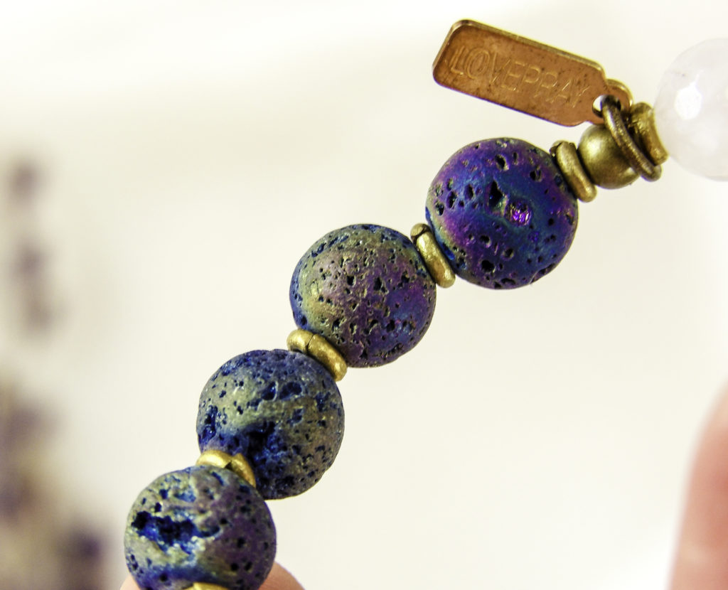 Close up of LovePray lava beads. The porous beads hold essential oils all day long