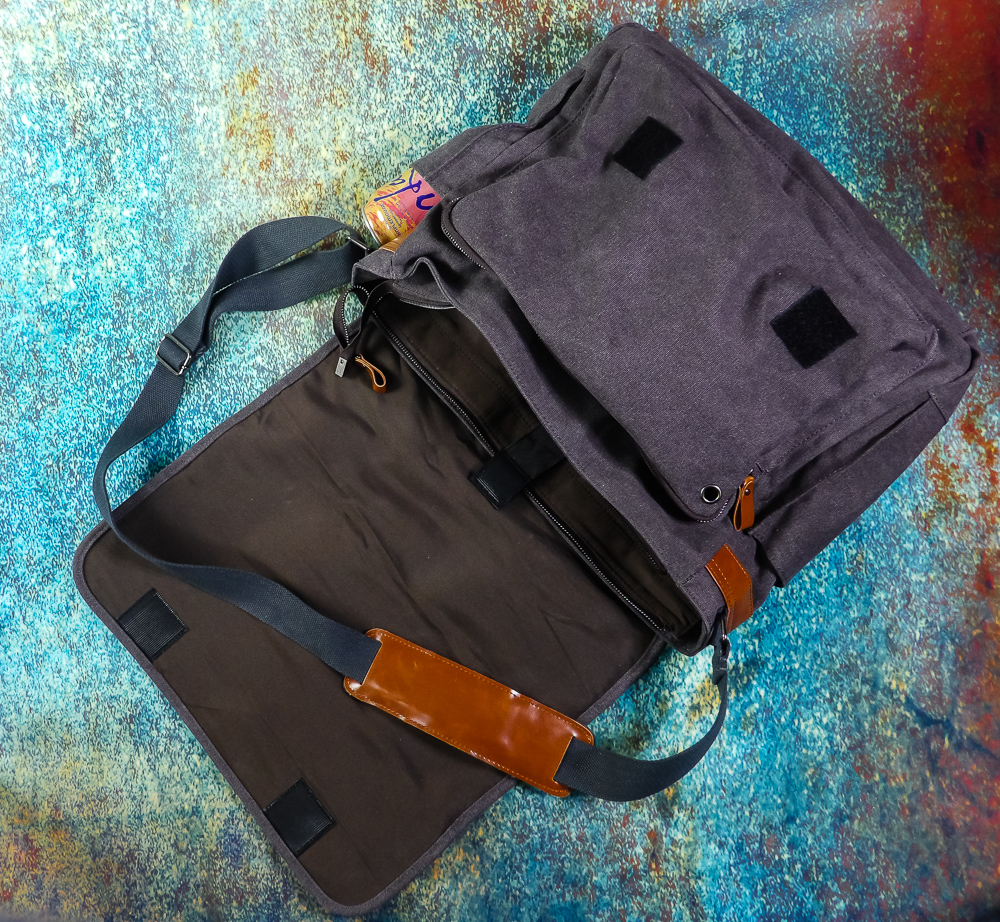 A versatile, sturdy laptop bag with lots of pockets and secure velcro on the outer flap, multiple zippers and velcro secure strap on the laptop compartment