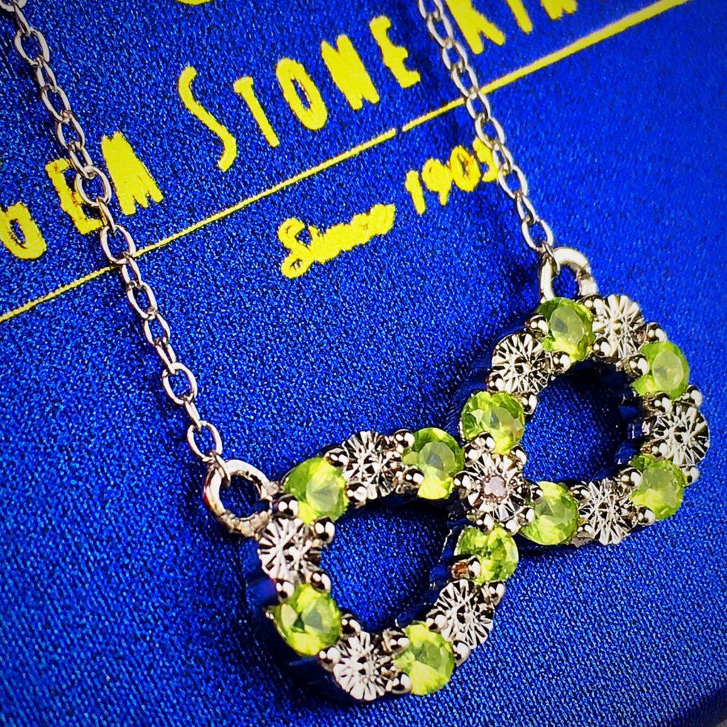 Gem Stone King Peridot and Diamond Infinity Necklace Pendant