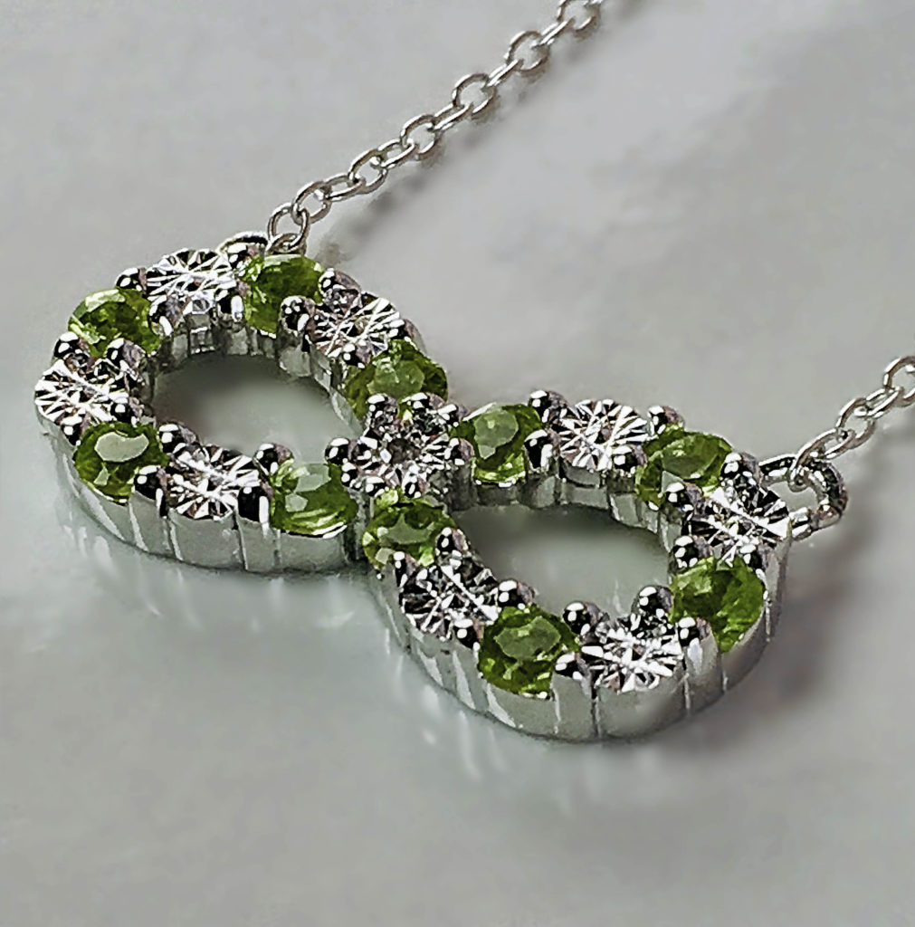 Just in time for spring: the Gem Stone King Peridot and Diamond Infinity Pendant on a Sterling Silver chain