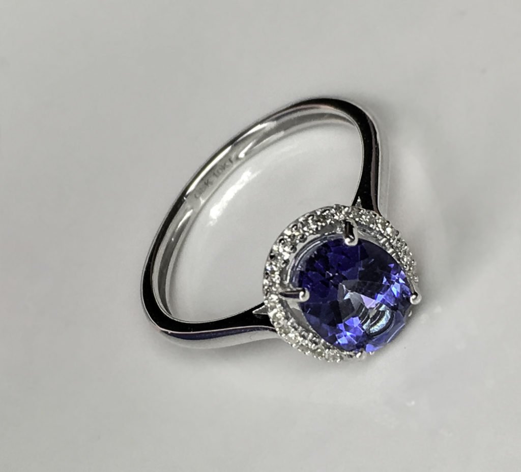 Blue Mystic Topaz has a deep blue color but retains the depth and brilliance of a traditional engagement ring kind of sparkle