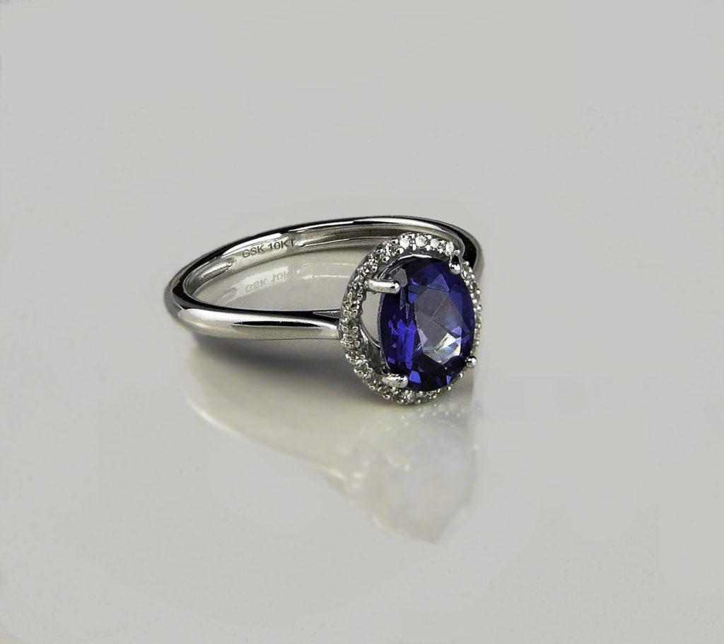Gem Stone King Blue Mystic Topaz and Diamond Engagement Ring