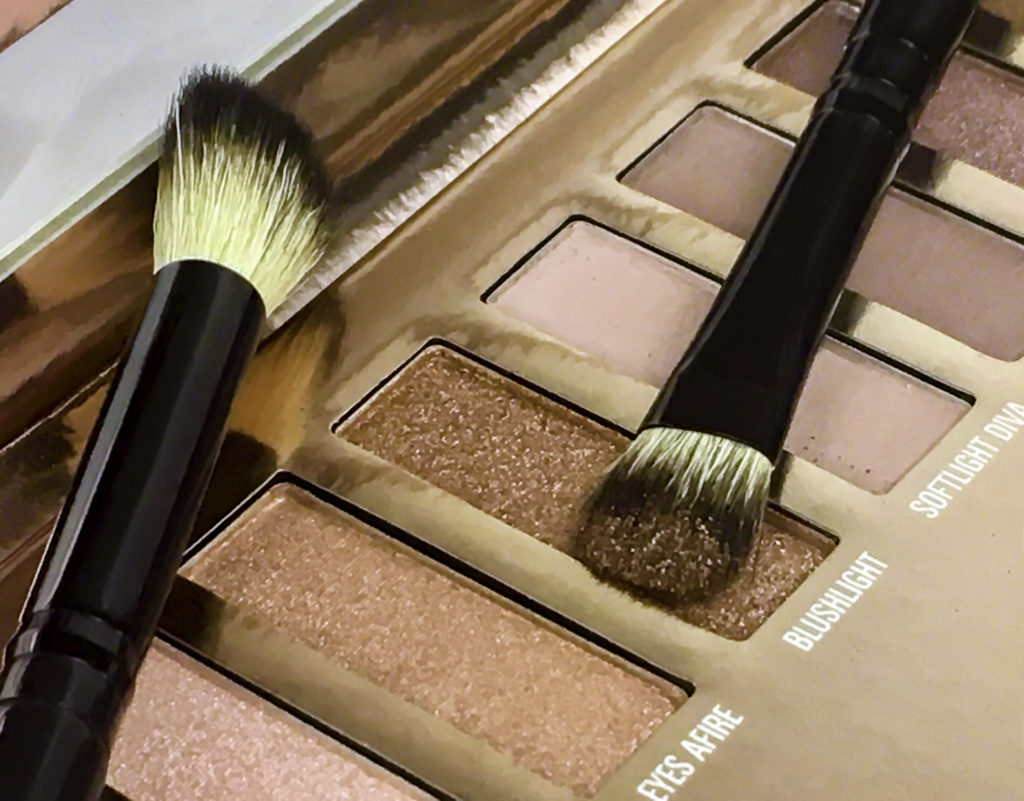 LuxLight Palette and Essential Brush Set. Brush is loaded with Brushlight, a shimmering copper shade