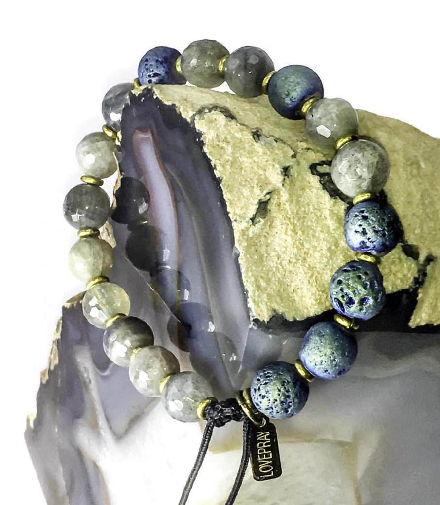 This LovePray Labradorite uses ethical gemstones, natural lava beads, and handmade brass ring beads
