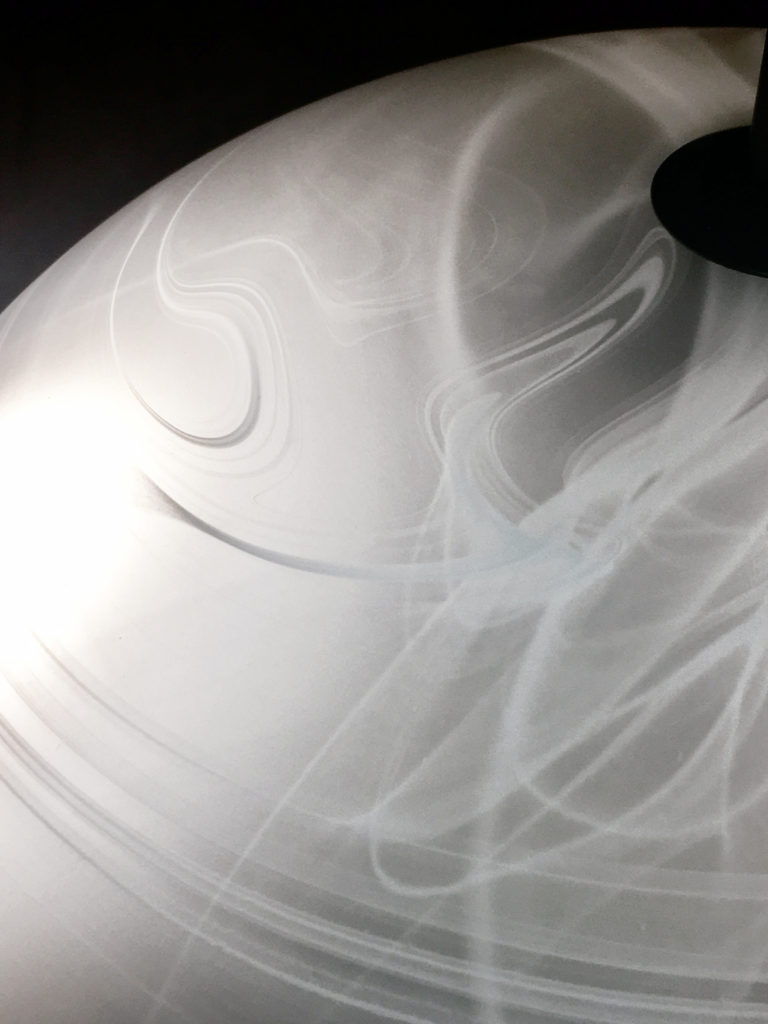 Marbled glass shade provides clear but soft white light